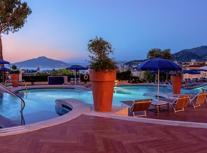 Outdoor Pool and Lounge Area at Dusk