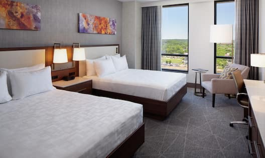 Guest Room with Two Queen sized Beds and Desk