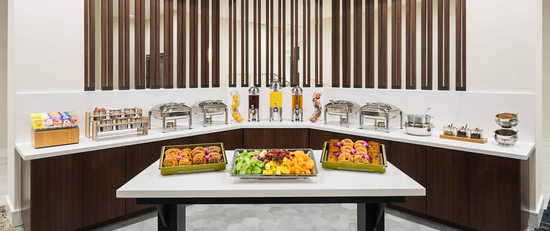 Breakfast Buffet Area with Various Types of Breakfast Beverages