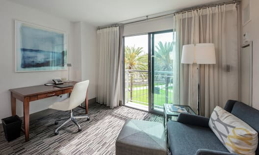 Suite Living Area with Soft Chair and Work Desk