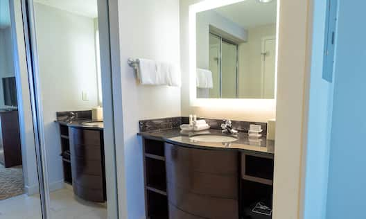 Suite Bathroom with Sink and Mirrors