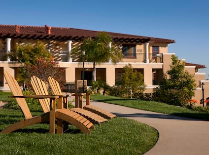 Hilton Grand Vacations Club at MarBrisa, CA - Exterior With Deck Chairs