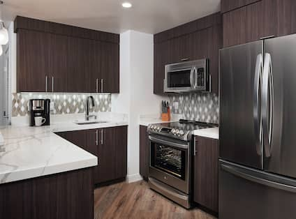 Kitchen with fridge and sink