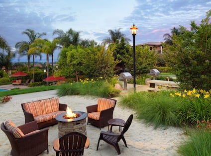 Seating Around Firepit by Grill Area and Pool