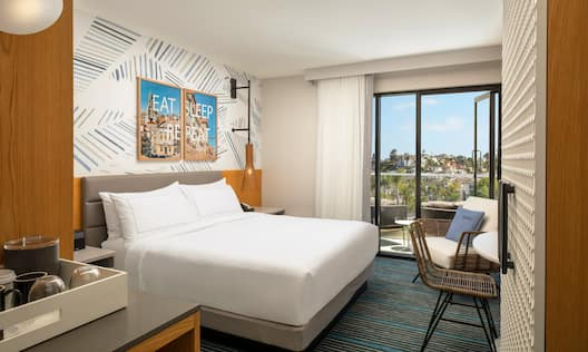 King Guest Room with Balcony and City View