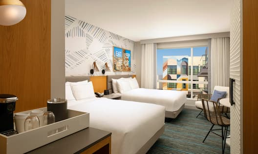 Two Beds in Guest Room with Desk and City View