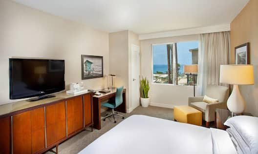King Bed, Work Desk, TV and Ocean and Pool View