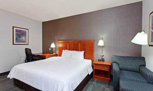 Accessible King Guestroom with Bed, Lounge Area, and Work Desk