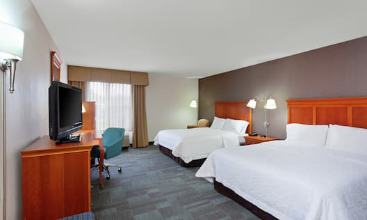 Accessible Guestroom with Two Queen Beds, Lounge Area, Room Technology, and Work Desk