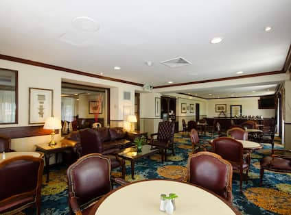 Executive Lounge Seating Area with Tables and Chairs