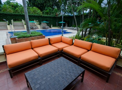 Outdoor Terrace Seating Area with Sofa and Coffee Table