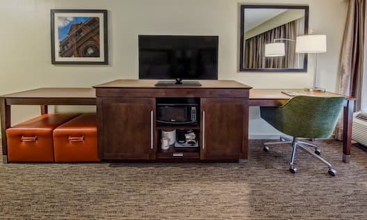 Guest Room With TV And Workspace