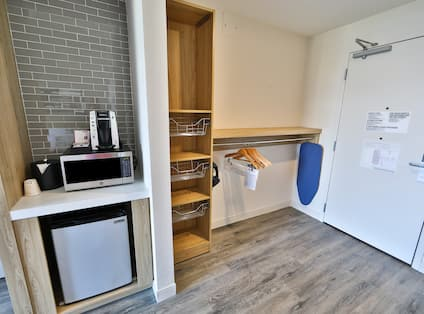 Guest Room Entry with Closet, Mini Refrigerator and Microwave