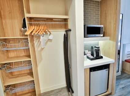 Guest Room Closet, Mini Refrigerator, Microwave and Coffee Station