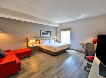 King Guest Room with Lounge Area and Work Desk