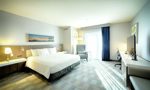 Guest Room with a King sized Bed Desk and TV