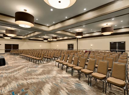 Ballroom Theater Setup with Rows of Chairs