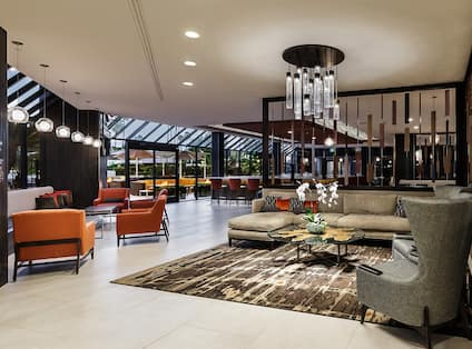 Lobby Seating Area with Armchairs, Coffee Table and Sofa