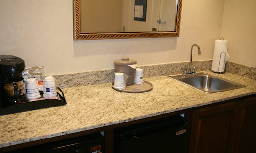 Kitchen sink area with coffee maker