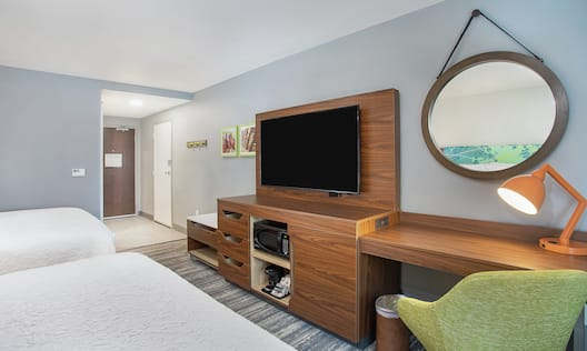 Guestroom with Two Beds, Work Desk, and Room Technology