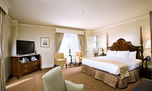 Standard King Guest Room with king bed, tv and chairs
