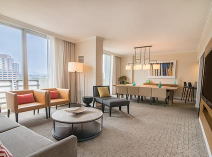 Living Room with Chairs and Table in Presidential Suite