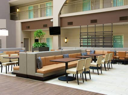 Breakfast area with tables and chairs