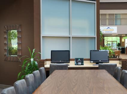 Business center with desk and monitors