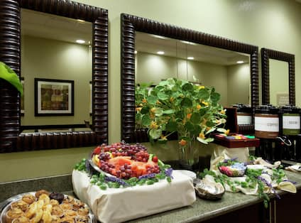 Detailed View of Catering on Refreshment Area in Boardroom With Wall Mirrors