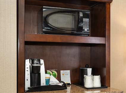 Guest Room Kitchenette With Microwave, Keurig, and Ice Bucket