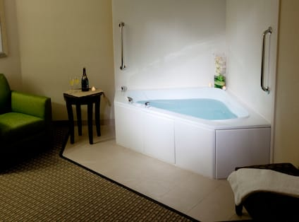 Wall Art, Armchair, and Whirlpool in Spa King Room