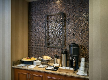 Detailed View of Catered Snacks and Beverages on Counter in Meeting Room