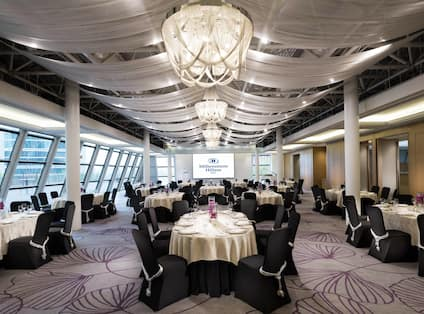 Meeting Room with Round Tables and Large Windows