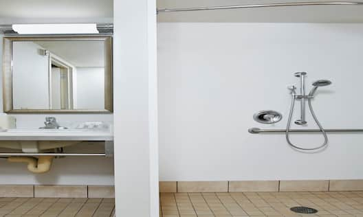 Accessible bathroom with sink and mirror