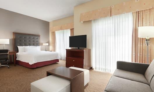 Queen Bed, Sofa and TV in Studio Suite