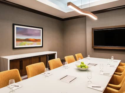 Conference Room with a Table, Chairs, and Room Technology