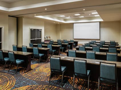Ballroom with Projector, Tables, and Chairs