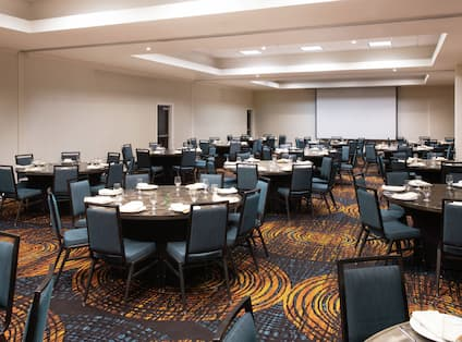 Walnut Creek Ballroom with Tables, Chairs, and Projector Screen