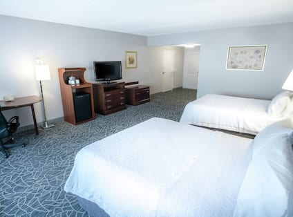 Accessible Double Queen Bedroom with Desk Fridge and TV
