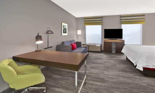 Studio Suite With a King Bed, Sofa Bed, TV, Desk, and Chair