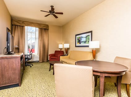 Suite Living Area with Sofa HDTV Table and Chairs