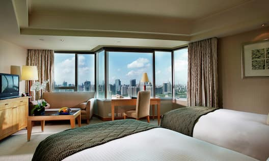 Two Twin Beds, Desk and View of City
