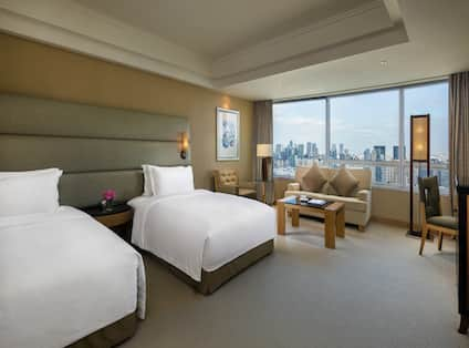 Twin Beds Guest Bedroom with Sofa, Coffee Table and City View