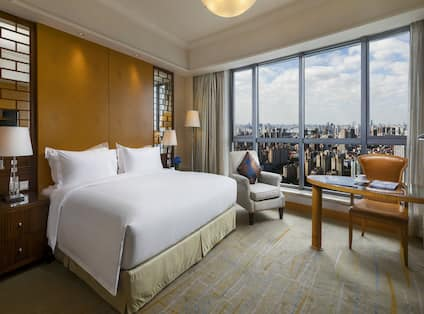 One King Bed Guest Bedroom with Armchair, Work Desk and City View