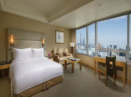 One King Bed Guest Bedroom with Sofa, Coffee Table, Work Desk and City View