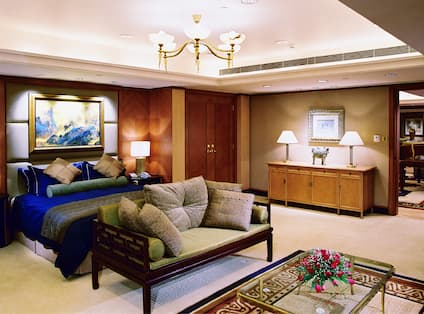 Suite Bedroom with King Bed and Seating Bench