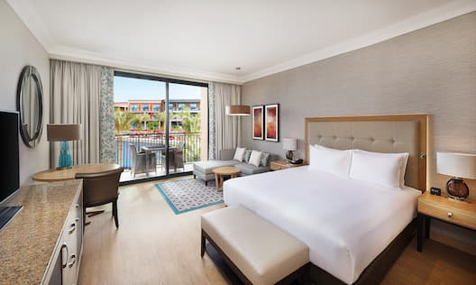 One King Bed Guest Bedroom with HDTV, Work Desk, Sofa and Outdoor Balcony