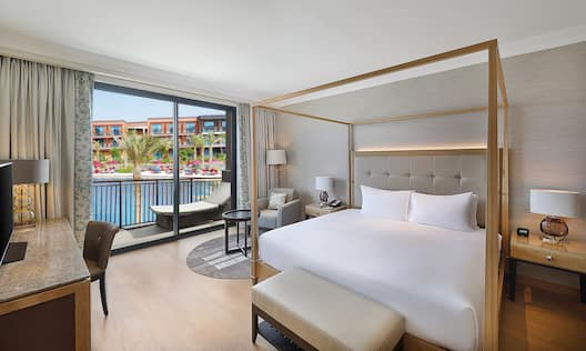One King Bed Guest Bedroom with HDTV, Work Desk, Armchair and Outside Balcony