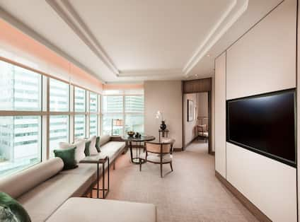 Centennial Suite Living Room wiith Large Windows and Seating Area