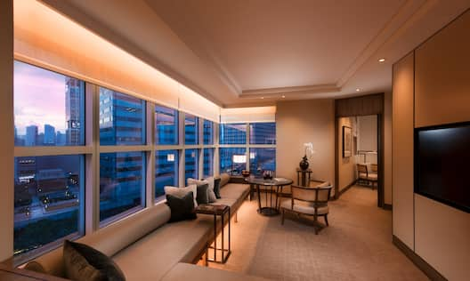 Centennial Suite Living Room with Large Window Seating Area TV Table and Chair